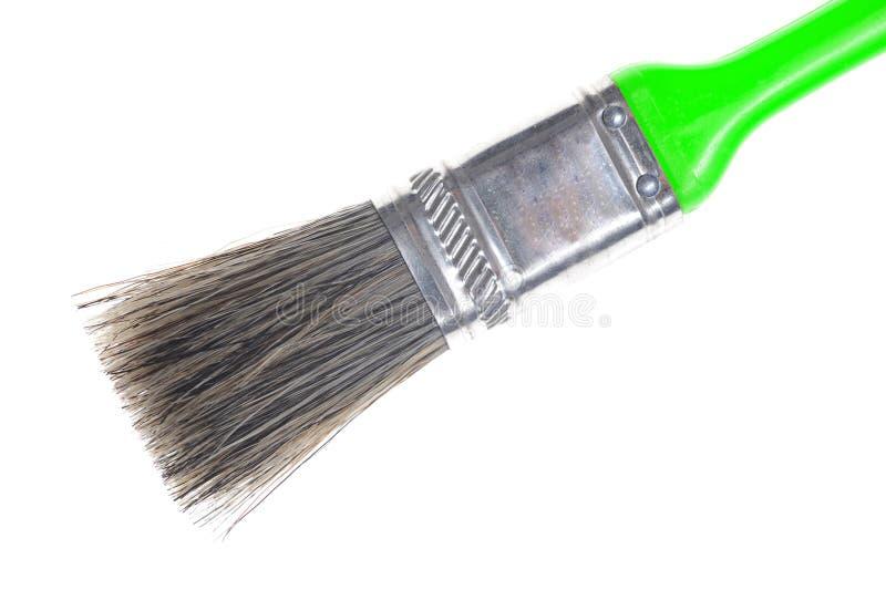 清洗绿色油漆刷 免版税库存图片