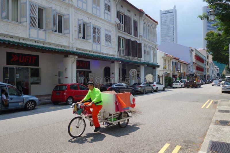 清洗Amoy街道,新加坡街市的工作者 库存图片