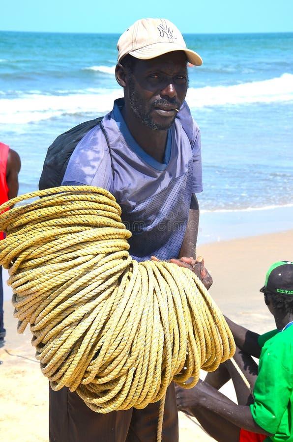 渔夫冈比亚海滩 免版税图库摄影