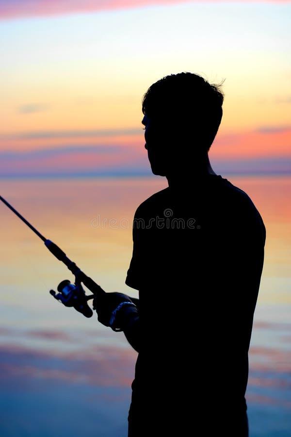 渔夫剪影 免版税库存图片