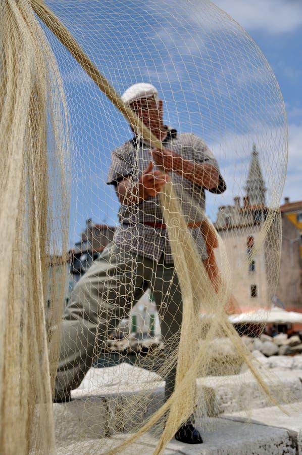 渔夫和一个捕鱼网 库存图片