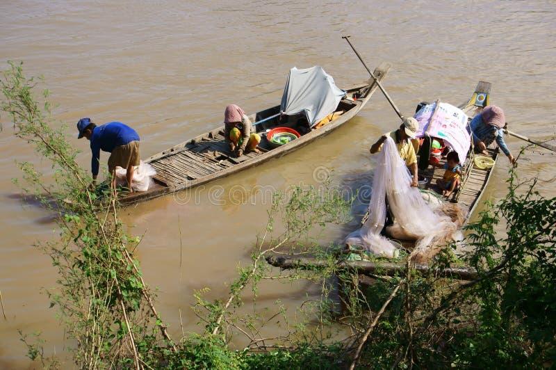 渔夫家庭做渔劈裂 库存图片