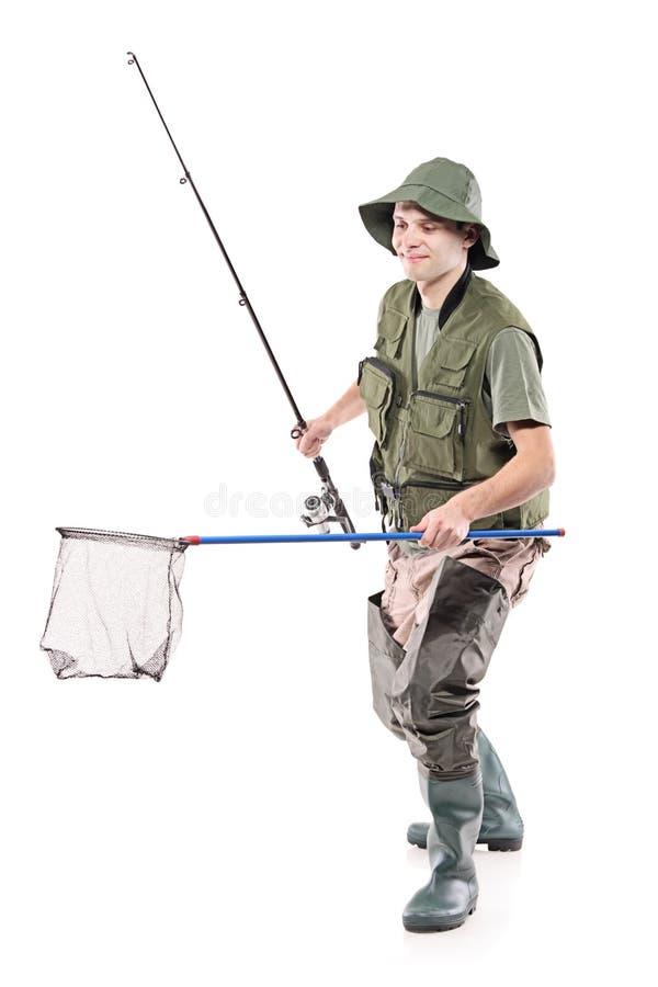 渔夫捕鱼藏品净额年轻人 免版税库存图片