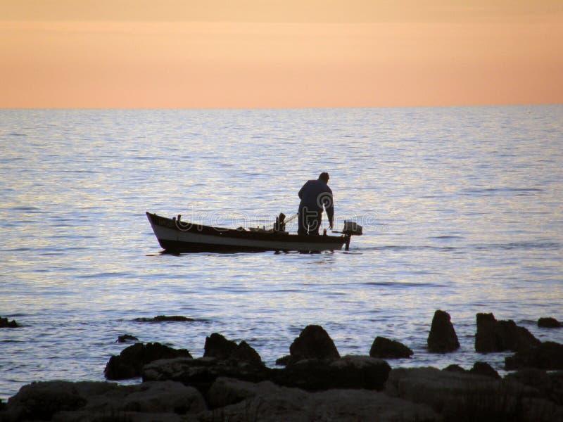 渔夫日落 免版税图库摄影