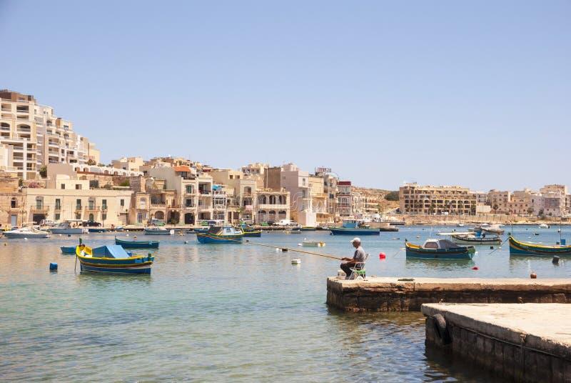 渔夫渔在马尔萨斯卡拉,马耳他 免版税库存图片