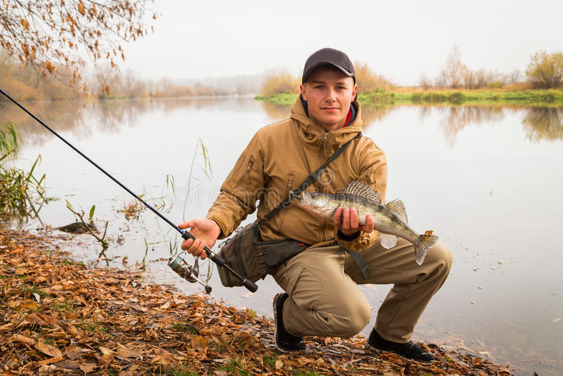 年轻渔夫 库存照片