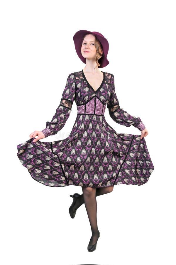 温文地跳舞在礼服和帽子的妇女 免版税图库摄影
