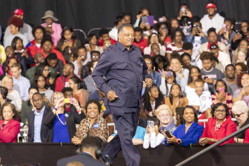 温斯顿萨兰姆, NC - 2016年10月27日:民权传奇Jessie杰克逊发表于希拉里・克林顿,并且米歇尔・奥巴马presiden 库存照片