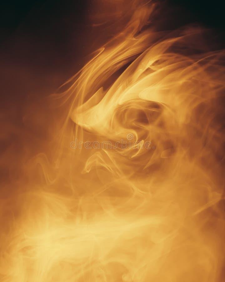 温暖的光在烟背景中 库存图片