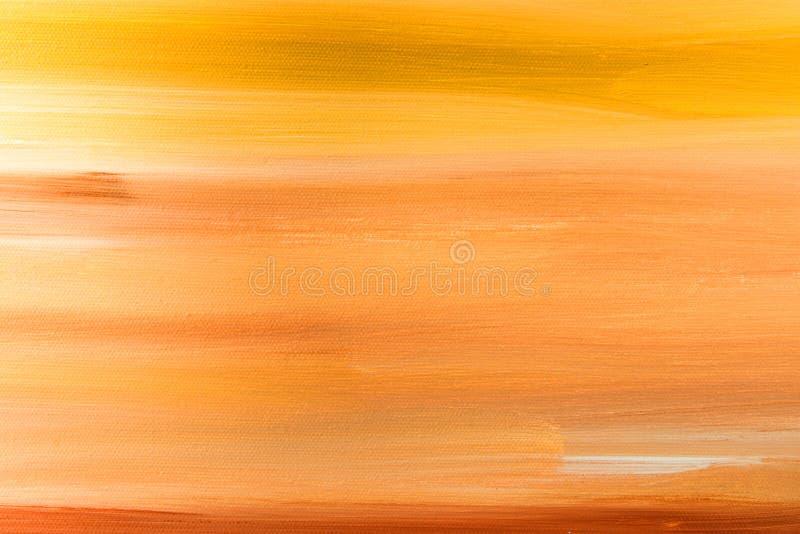 温暖的颜色美好的抽象梯度橙黄红色背景和树荫  在织地不很细帆布的油漆刷冲程 免版税图库摄影