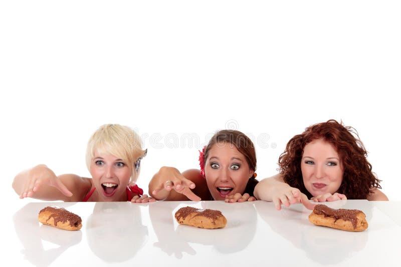 渴望有吸引力的眼睛三个妇女年轻人 库存照片