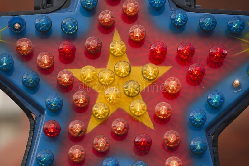 游乐园狂欢节月神公园移动的光背景 免版税库存照片