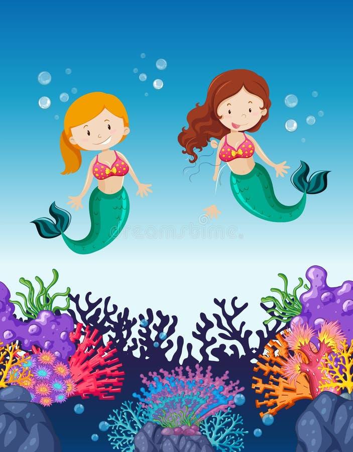 游泳在海洋下的两个美人鱼 库存例证