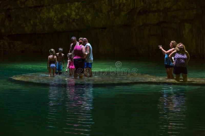 游泳在Cenote 图库摄影
