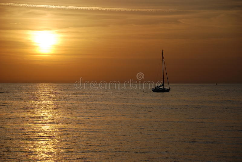 游艇和日落 库存照片