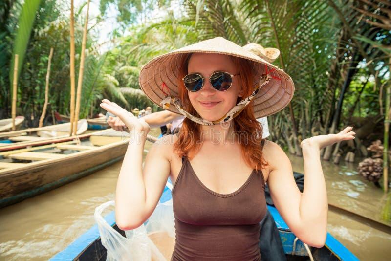 湄公河三角洲巡航的游人 库存图片