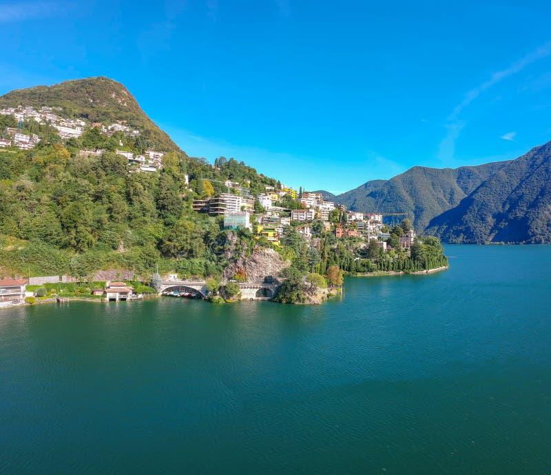 湖卢加诺,山和城市卢加诺,提契诺州的全景鸟瞰图小行政区,瑞士 风景美丽的瑞士镇与 图库摄影