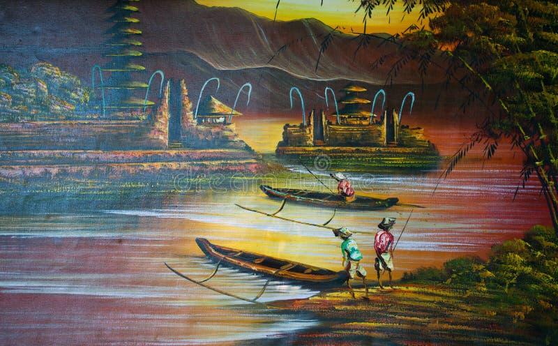 湖的渔夫在寺庙,巴厘岛,印度尼西亚附近 库存图片
