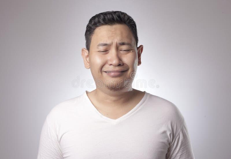 滑稽亚洲人哭泣 免版税库存图片