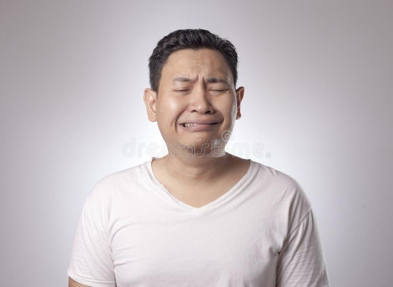 滑稽亚洲人哭泣 库存图片