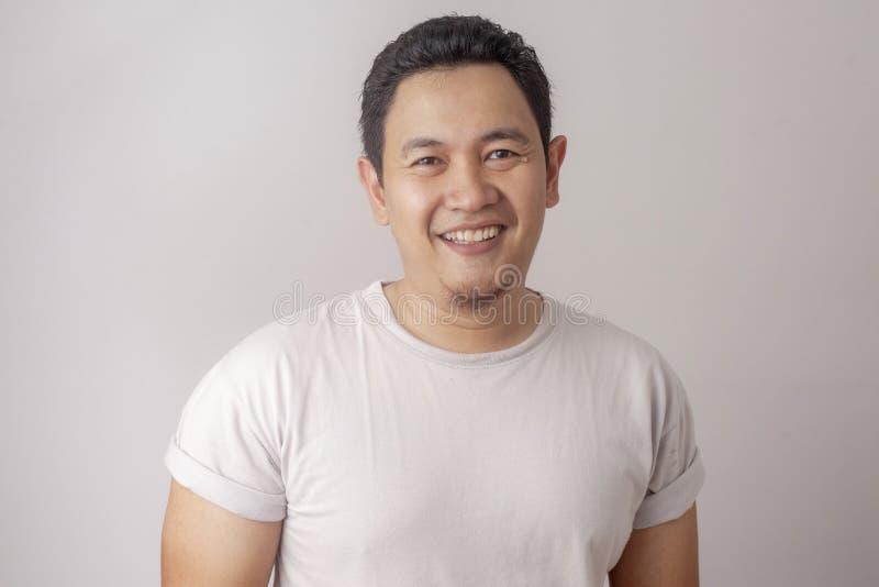 滑稽的亚裔人笑的微笑 免版税库存图片