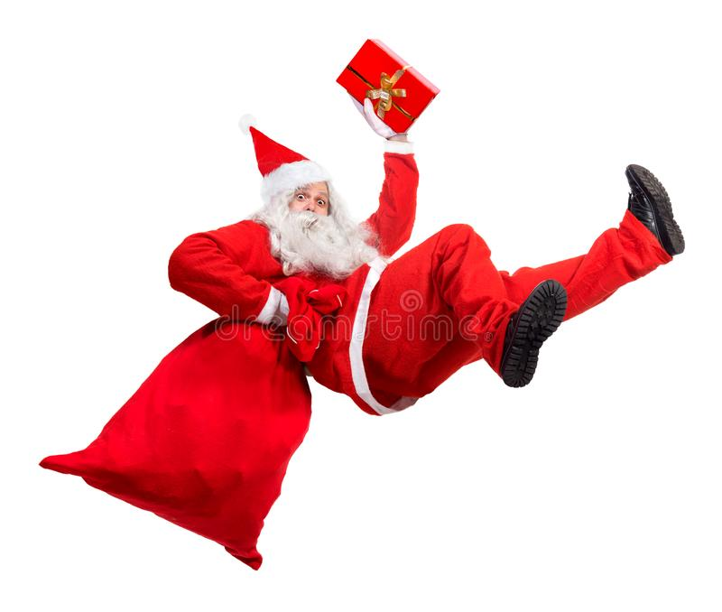 滑稽的圣诞老人跌倒与袋子有很多x-mas礼物 图库摄影