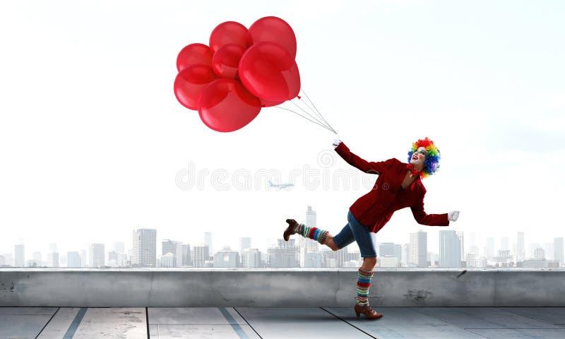 滑稽的妇女小丑 混合画法 库存照片