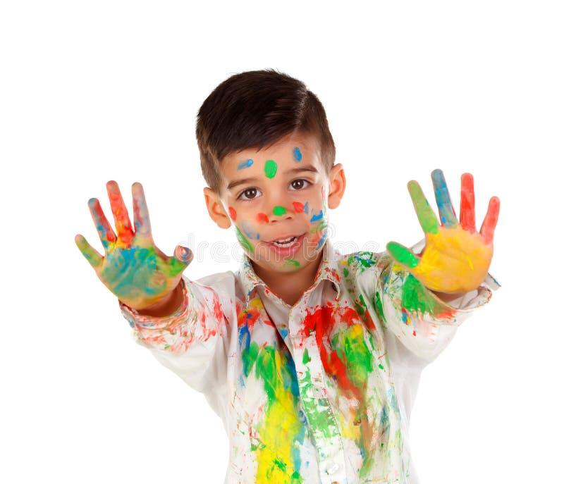 滑稽的男孩用充分手和面孔的油漆 图库摄影