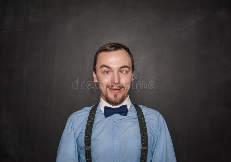 滑稽的疯狂的老师或商人黑板的 免版税库存图片