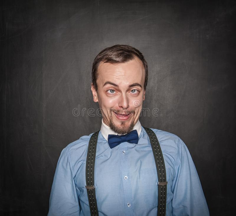 滑稽的疯狂的老师或商人黑板的 库存照片