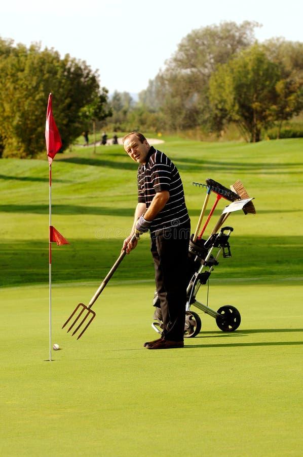 滑稽的高尔夫球运动员 图库摄影