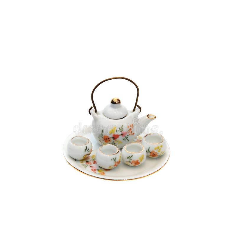 滚保龄球微小纪念品的茶壶 免版税库存图片