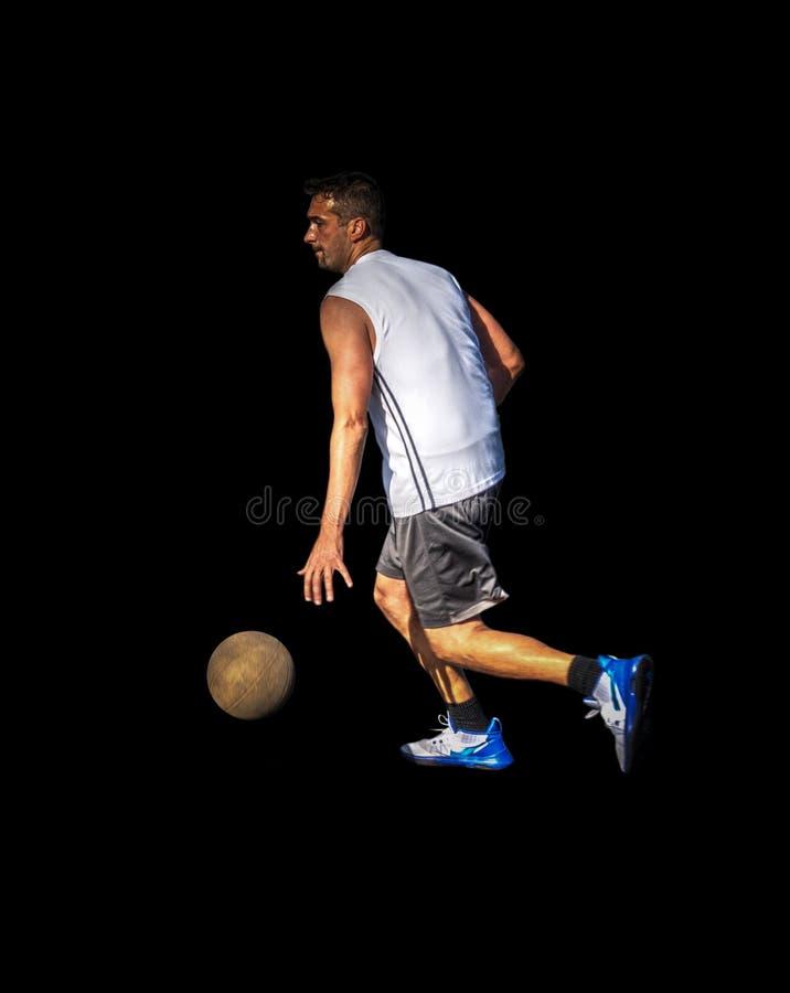 滴下在黑色的蓝球运动员的侧视图 库存图片