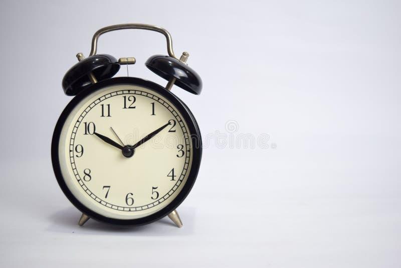 滴答作响对10点的时钟隔绝在白色背景 免版税图库摄影