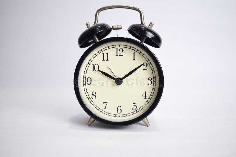 滴答作响对10点的时钟隔绝在白色背景 免版税库存照片