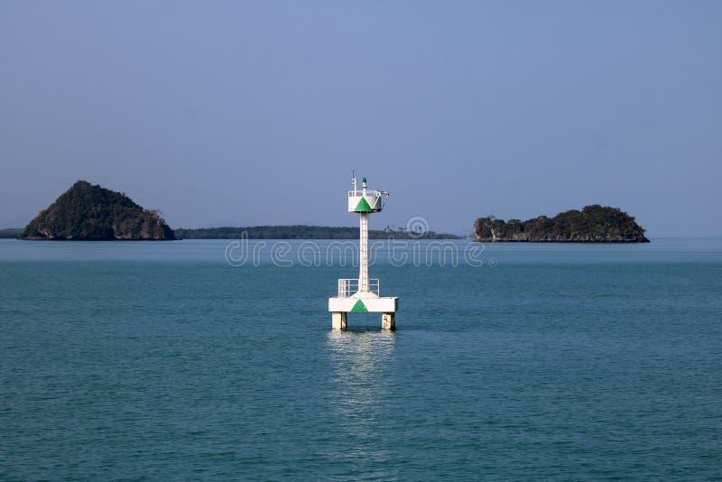 漂浮在海的白色浮体航海或侧向标记 免版税库存照片
