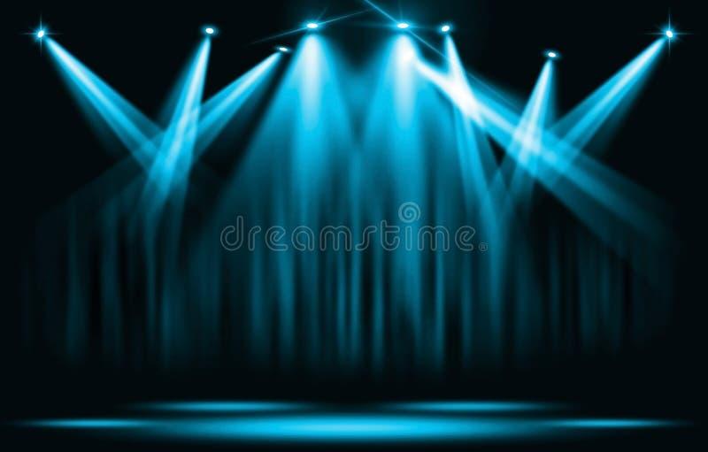 演出光 与确定蓝色聚光灯通过黑暗 免版税库存照片
