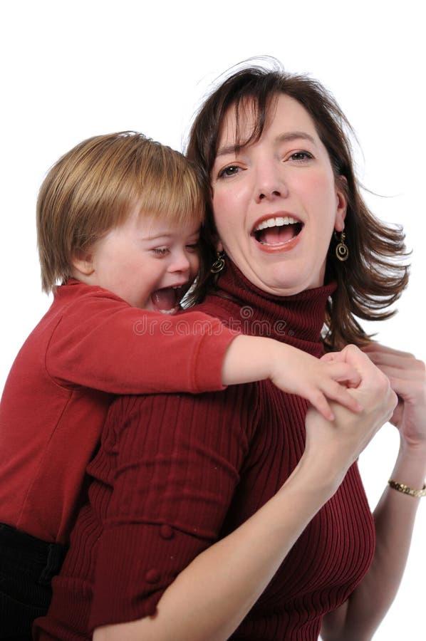 演奏儿子的母亲 库存图片
