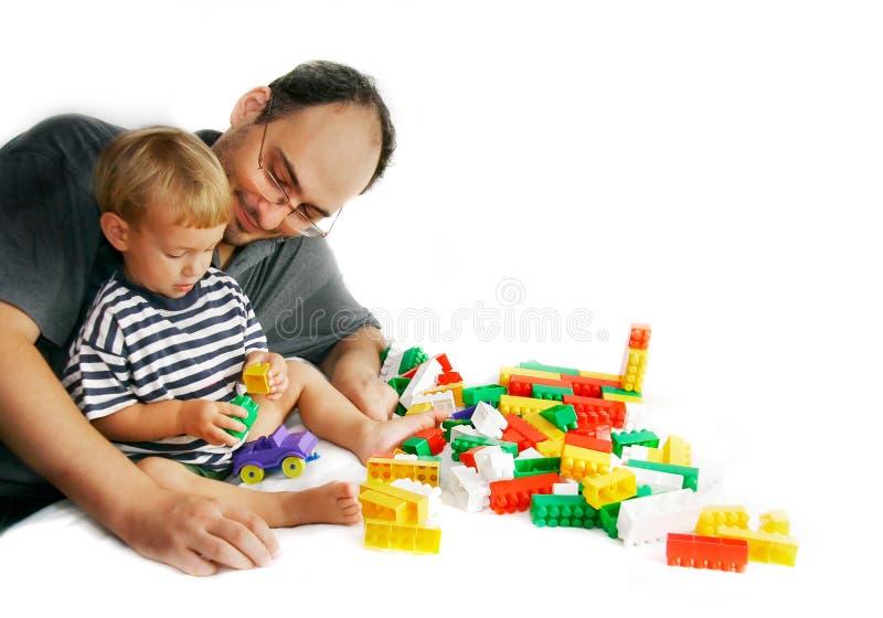 演奏儿子的父亲 免版税图库摄影