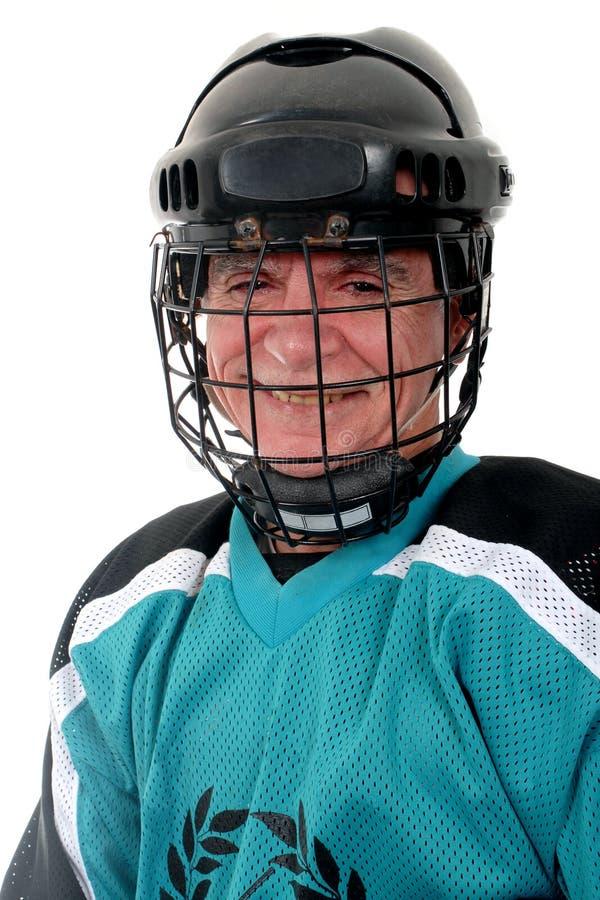 演奏前辈的曲棍球冰 免版税图库摄影