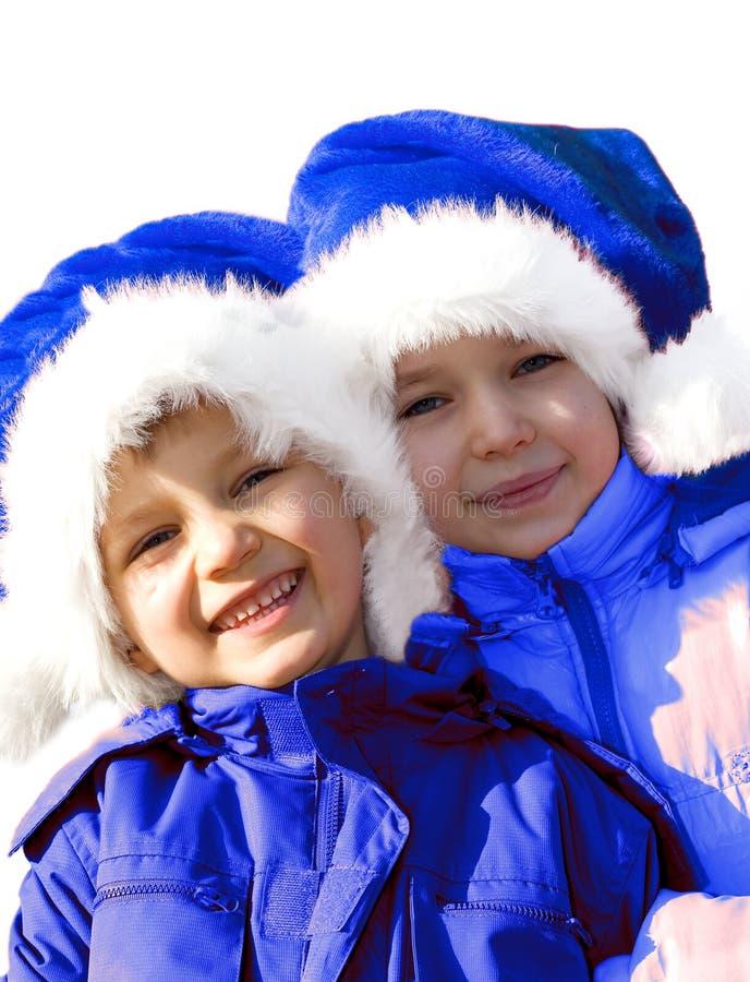 演奏圣诞老人的蓝色克劳斯孩子 库存照片
