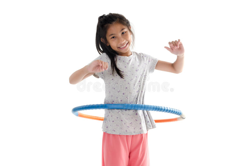 演奏在白色背景的愉快的女孩hula箍 图库摄影