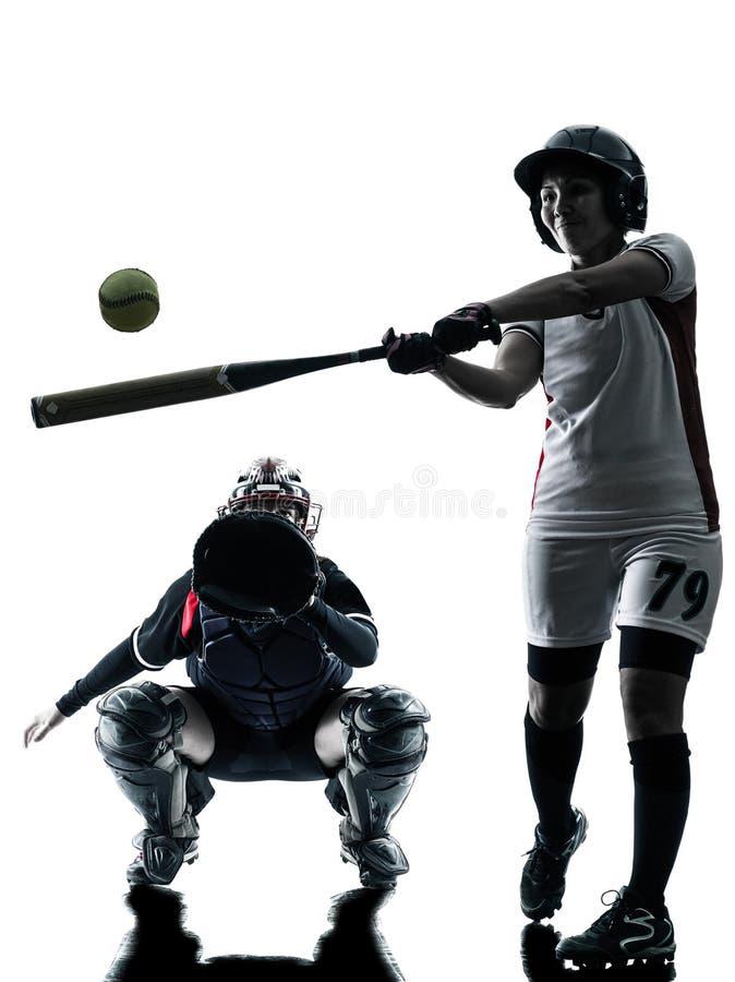 演奏垒球运动员剪影的妇女被隔绝 免版税图库摄影