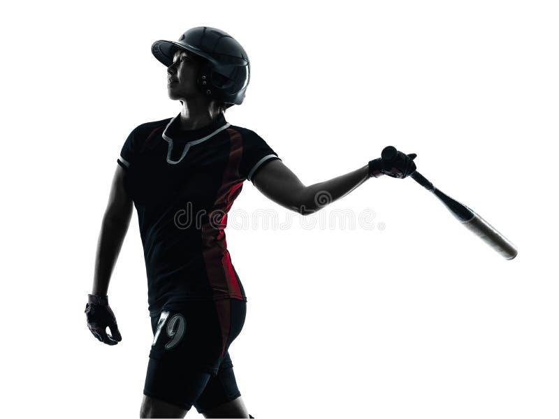 演奏垒球运动员剪影的妇女被隔绝 免版税库存照片
