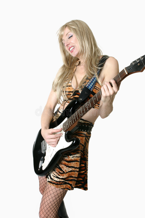 演奏妇女的电吉他 免版税库存图片