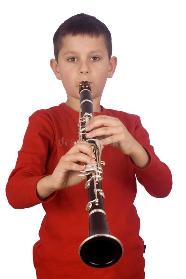 演奏年轻人的男孩 免版税库存照片