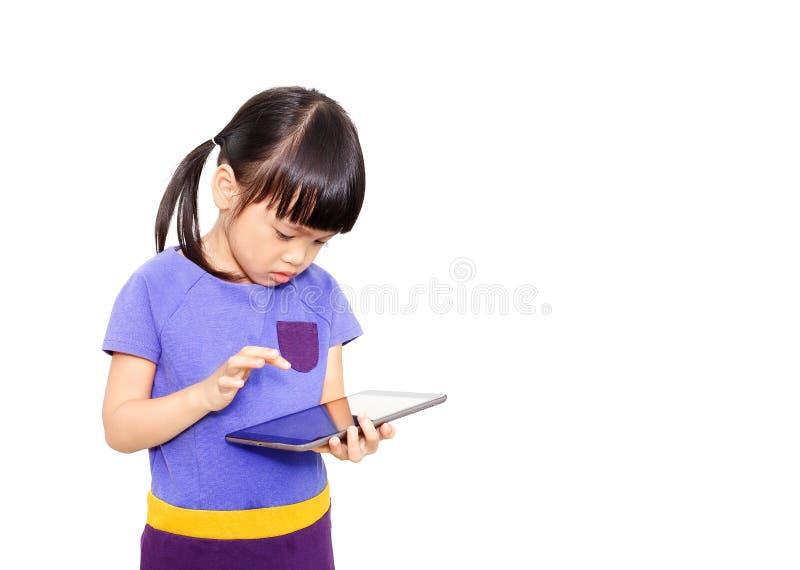 演奏片剂的孩子 免版税图库摄影