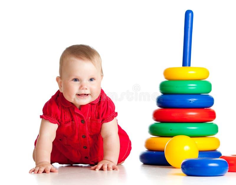演奏玩具的婴孩颜色 库存图片