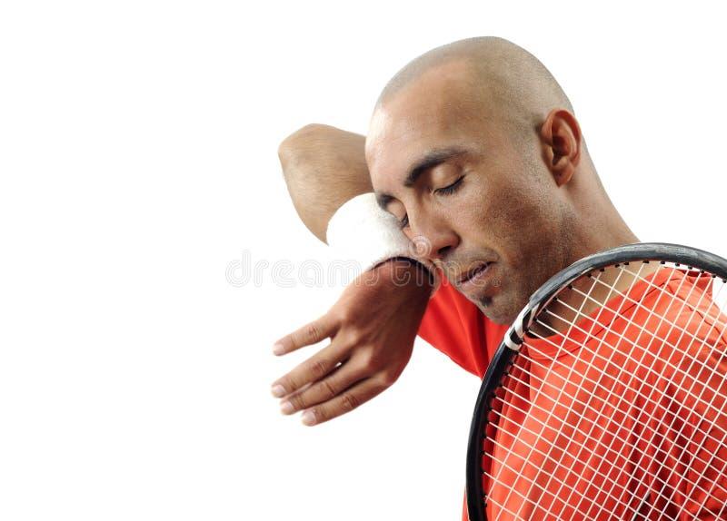 演奏纵向网球年轻人的可爱的人 免版税图库摄影