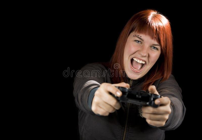 演奏计算机游戏的女孩 库存图片